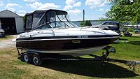 2003 Four Winns 205 Horizon Cuddy with factory trailer sold by a marine, boat and yacht broker in the Pickering, Whitby, Bowmanville, Peterborough, Belleville, Trenton and Brighton areas of  Ontario, Canada.